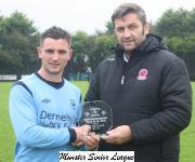 Avondale Utd v UCC Sn- John Finnigan presenting man of match award to   Josh O Shea Avondale