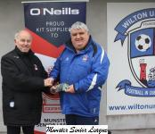 Barry Gould presentingthe O'Neills club of the week voucher to John Leanord Wilton Utd