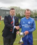 Barry Cotter MSL Presents the Senior 1st Div League Trophy to Everton Capt Laurence Fitzpatrick