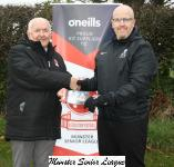 Peadar O'Leary presents the O'Neills club of the week voucher to Dave McCarthy UCC