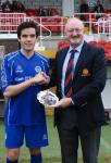 Junior Super Cup Final St.Mary's V Everton, DAVID MURPHY Everton , receives the Man of the match award from Pat Quinn MSL