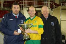 Barry Cotter & Tony Murphy Presenting Donie Ford cup to Ken Hoey Capt Rockmount AFC