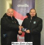Peader O'Leary presents Mayfield Utd's Adrian Saville with O Neill club of the week voucher