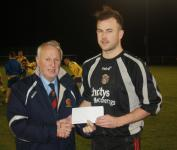 Castleview-Pat Lyons presents the man of the match award to mark Kenefick, Douglas Hall- Castleview v Douglas Hall
