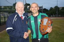 Tony Murphy MSL presents the floodlit shield to Mark Daly captain Mayfield Utd