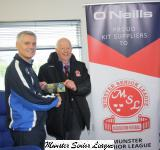 Tony Murphy presents the O'Neills Club of the Week voucher to David Gellan College Corinthians