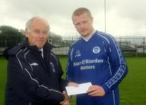 Everton-Barry Gould presenting match of week award to Shane Sexton Everton. v Passage