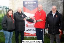 Leslie Doyle MSL presents the O'Neils club  of week voucher to James Wilson Casement with Leona Mulcahy and Eddie Hynes