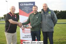 Sean O'Sullivan Presents the O'Neils Club of the week Voucher to Billy Cronin, Rockmount also in photo John O'Shea Rockmount
