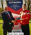 Pat Quinn MSL, presents the O'Neill's club of the week voucher to Carl O'Donovan Mallow.
