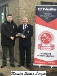 Barry Cotter presents the O'Niells Club of the week voucher to Douglas Hall President Dinny Carroll