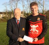 UCC - Michael Foley presenting the man of match  award to Darragh Lucy UCC,  UCC V Mayfield Utd