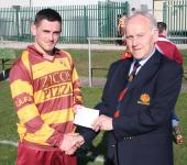 Ballincollig v Tramore Ath Sn-Barry Gould MSL presents the Man of the Match Award to Tramore Ath's Dave McCarthy