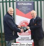 Pat lyons presents the O'Neills Club of the week Voucher to Vincent Drumm Ballincollig