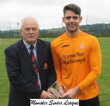 Ringmahon Rgs v Avondale Utd-Michael Foley MSL presenting the Beamish Stout man of match award to Avondale Utd's Dale Murphy