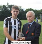 Wilton Utd v St.Mary's-Barry Gould MSL presenting the Beamish Stout man of the match award to Cian Murphy St Marys