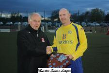 Barry Gould MSL presenting the Floodlit shield to Gavin Roche - Captain Douglas Hall