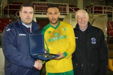 Barry Cotter & Tony Murphy presenting Donie Ford Final Man of the match award to Chris Achigbe Rockmount v St Mary's