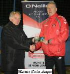 Barry Gould presents the O'Niels club of the week voucher to Sean Cotter Crofton Celtic