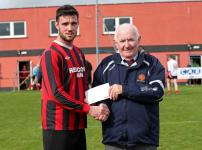 Ringmahon Rgs v Bandon- Roy Long, Ringmahon Rgs, receives the Man of the Match Award from Peadar O'Leary MSL