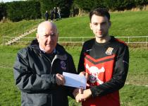 Bandon- UCC's Danial Pender receives the man of the match award from Peader O'Leary MSL- Bandon v UCC
