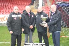 Pat Keane ( Keans Jewelers, Sponcer) presents the Keane cup to the MSL prior to the Keane Cup Final