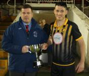 Barry Cotter MSL, presents the Donie Forde Trophy to Cobh Wnds Capt Conor Meade