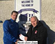 Barry Gould presenting the O'Neills Club of the week Voucher to Daire Coughlan Ballinhassig