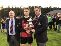 UCC Capt Sean O'Mahony receives the Beamish Stout Snr Prem Div trophy from MSL's John Finnigan with  MSL's Pat Quinn