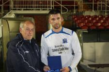 Jn League Cup Final - Leeds v Rockmount Owen Quirke receives the Man of the Match award from Barry Gould MSL