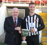 Peader O'Leary MSL presents the Beamish Stout Senior Cup to Midleton Capt