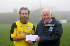 Ballinhssig, Peader O'Leary presents the Man of the Match award to Riverstowns Barry O'Sullivan-Ballinhassig v Riverstown