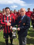 Ringmahon B Capt Alex Ahern receives the Junior Premier league trophy from Barry Gould MSL