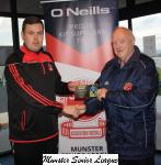 Barry Cotter presents the O'Niells Club of the week voucher to Eddie Allan Midleton