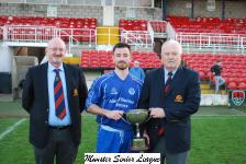 MSL's Michael Foley presents the Junior League Cup to Everton Capt Graeme Browne with Pat Quinn MSL