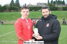 Bandon v Kinsale-John Finnigan presenting the man of match award to Cathal Manning Bandon