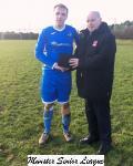 Ballinhassig v Carrigaline Utd-Barry Gould MSL presenting the man of match award to Michael Ahern Ballinhassig