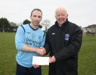 Avondale-Karl Caulfield receiving man of the match award from Tony Murphy MSL-Avondale td v Rockmount AFC