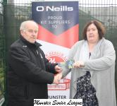 Barry Gould presents the O'Neills club of week voucher to Trina O'Neill chairperson of Kinsale