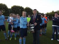 John Finnegan MSL presents the Senior Premier League Trophy to Michael Mulconroy Capt Avondale Utd