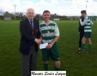 Park Utd v Ballinhassig-Michael Foley MSL presents the Man of the match award to Park Utd's David Murphy
