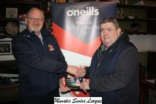 Pat Quinn presents Denis  Cummins of St Marys with the O'Neills Club of the week voucher