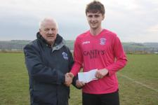 Kinsale v Ballinhassig Leslie Doyle, MSL presents the man of the match award to Ballinhassigs Jerome Glavin
