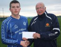 Everton v Wilton Utd-Donal Lenihan, MSL, presenting man of match award to Anthony Brothers Everton