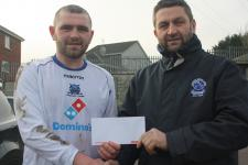 Leeds - Ciaran McCarthy receives the Beamish Stout man of the match award from John Finnegan MSL - Leeds v Wilton Utd