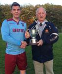 Sean O'Sullivan Hon. Secretary MSL  presenting the Beamish Stout junior first division cup to Lee Desmond captain Youghal United