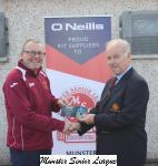 Barry Gould presenting O Neills Club of the week Voucher to Paul   O Connell Tramore Ath