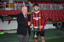 Beamish Senior Cup- Ringmahon Rgs Capt Paul Deasy receives the Senior Cup from Peader O'Leary MSL