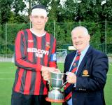 Leslie Doyle MSL presenting the Pop Keller Cup to Derek O'Sullivan Captain R/mahon Rangers senior team
