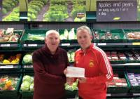 Club Chairman Finian Joyce receiving a community fund cheque from John Gleeson of Tesco Castlebar